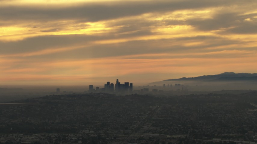 HD aerial video of a smoggy skyline, cloudy, Downtown Los Angeles, California, sunset Aerial Stock Footage | CBAX01_084