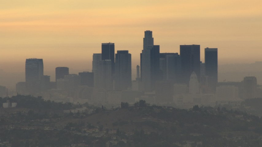 HD stock footage aerial video of a smoggy skyline, Downtown Los Angeles, California, sunset Aerial Stock Footage | CBAX01_085