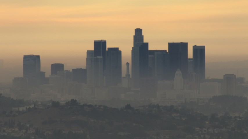 HD stock footage aerial video of the smoggy skyline, cloudy, Downtown Los Angeles, California, sunset Aerial Stock Footage | CBAX01_086