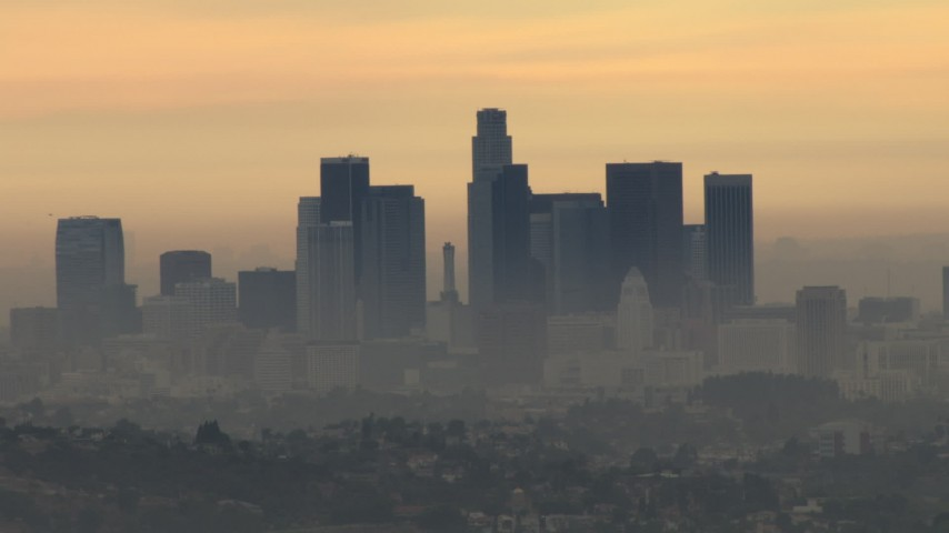 HD stock footage aerial video of the skyline with smog, Downtown Los Angeles, California, sunset Aerial Stock Footage | CBAX01_087