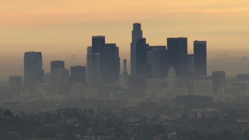 HD stock footage aerial video of the smoggy skyline of Downtown Los Angeles, California, sunset Aerial Stock Footage | CBAX01_088
