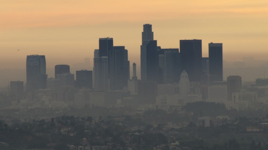 HD stock footage aerial video of the skyline with thick smog, Downtown Los Angeles, California, sunset Aerial Stock Footage | CBAX01_089