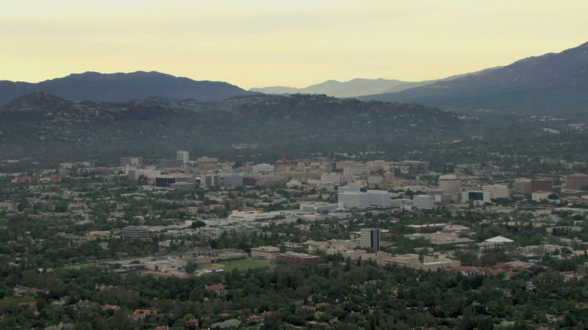 HD stock footage aerial video of zooming out to wider view of the city and hills, Pasadena, California Aerial Stock Footage | CBAX01_097