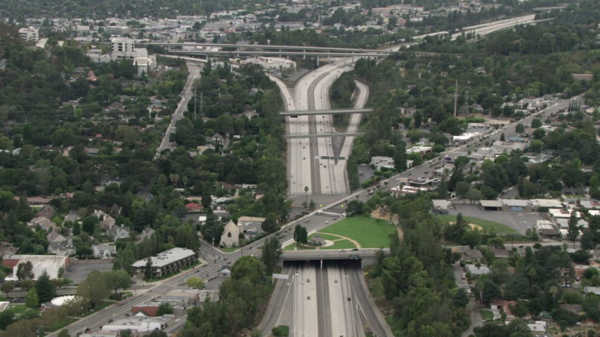 HD stock footage aerial video of Interstate 210, Foothill Boulevard overpass, Highway 2 interchange, La Cañada Flintridge, California Aerial Stock Footage | CBAX01_112