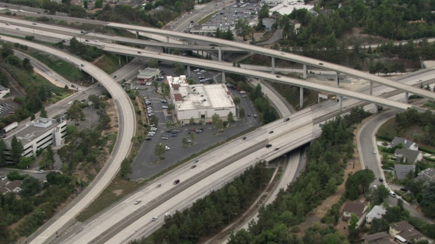 HD stock footage aerial video of a store at the center of a freeway interchange, La Cañada Flintridge, California Aerial Stock Footage | CBAX01_114