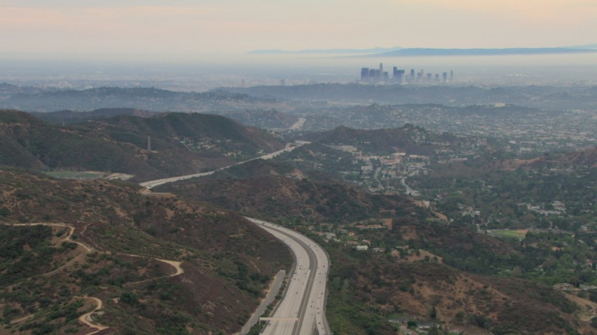 HD stock footage aerial video of a view of hazy downtown from Glendale hills, Downtown Los Angeles, California  Aerial Stock Footage | CBAX01_115