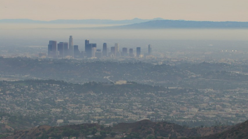 HD stock footage aerial video of passing by hazy Downtown Los Angeles, California Aerial Stock Footage | CBAX01_116