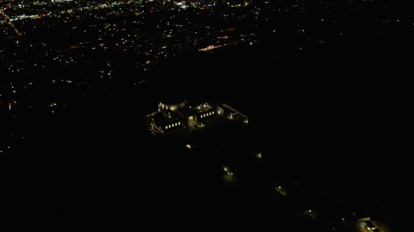5K stock footage aerial video flying by the Griffith Observatory at night, Los Angeles, California Aerial Stock Footage | DCA01_004