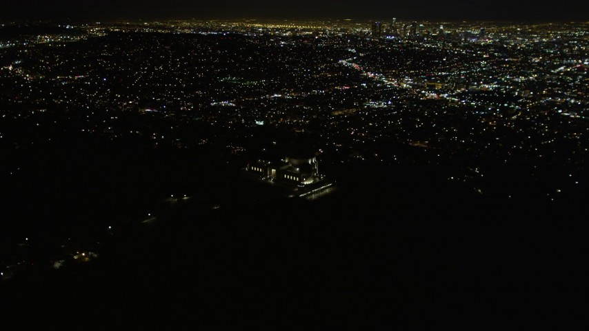 5K stock footage aerial video flying by the Griffith Observatory at night, Los Angeles, California Aerial Stock Footage | DCA01_005