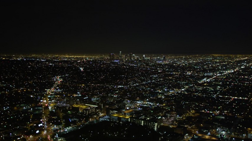5K stock footage aerial video approaching downtown Los Angeles skyline at night, California Aerial Stock Footage | DCA01_006