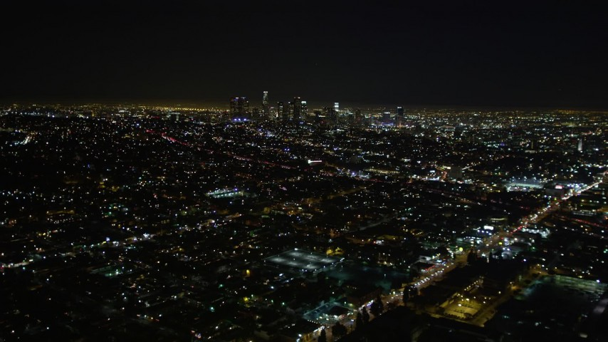 5K stock footage aerial video tilt up revealing downtown Los Angeles skyline at night, California Aerial Stock Footage | DCA01_007