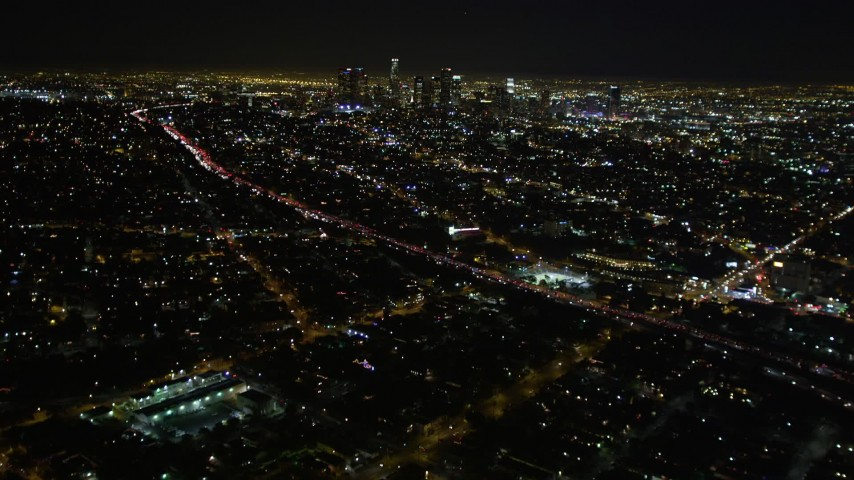 5K aerial video tilt up revealing downtown Los Angeles skyline, California Aerial Stock Footage | DCA01_008