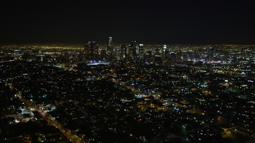 5K aerial video flying by downtown Los Angeles skyline at night, California Aerial Stock Footage | DCA01_010