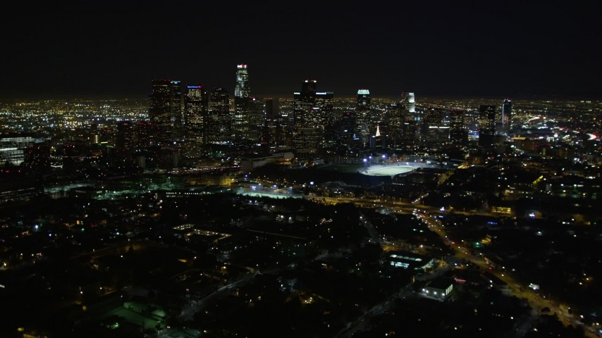 5K stock footage aerial video pan right revealing downtown Los Angeles skyline at night, California Aerial Stock Footage | DCA01_011
