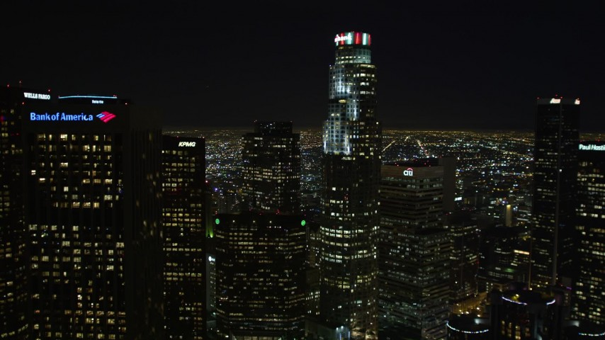 5K stock footage aerial video tilt from freeway to reveal Downtown Los Angeles skyscrapers and city lights, California Aerial Stock Footage | DCA01_013E