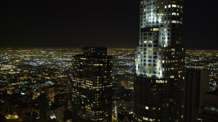 5K stock footage aerial video flying by US Bank Tower at night, Los Angeles, California Aerial Stock Footage | DCA01_014
