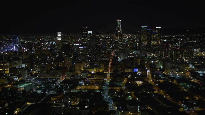 5K stock footage aerial video flying away from Downtown Los Angeles skyline at night, California Aerial Stock Footage | DCA01_015