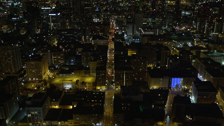 5K aerial video tilt up to reveal Downtown Los Angeles skyscrapers at night, California Aerial Stock Footage | DCA01_016