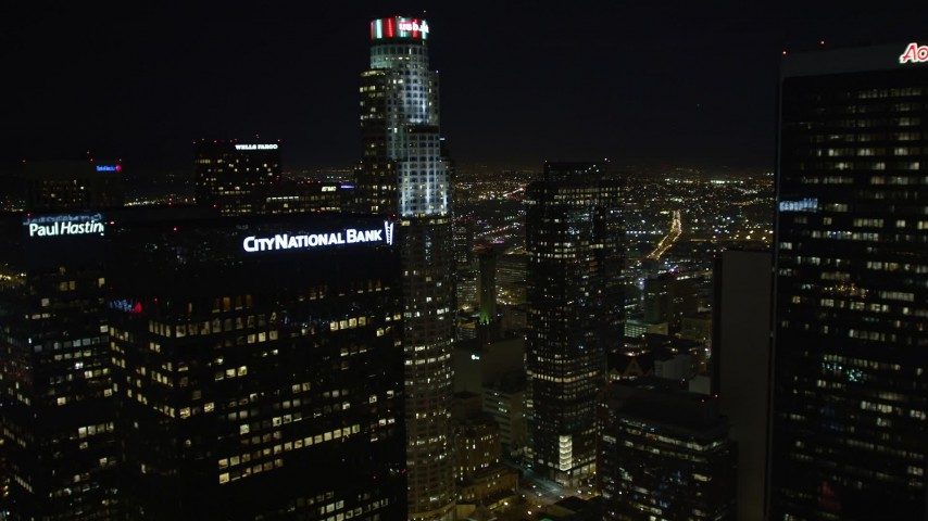 5K stock footage aerial video flying by skyscrapers revealing Los Angeles City Hall at night, California Aerial Stock Footage | DCA01_025