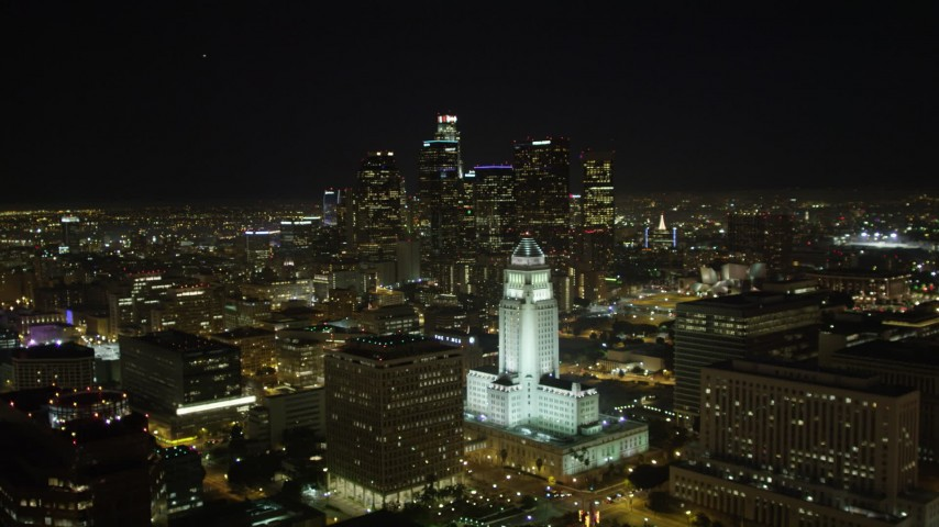 5K stock footage aerial video flying away from Los Angeles City Hall at night, California Aerial Stock Footage | DCA01_027