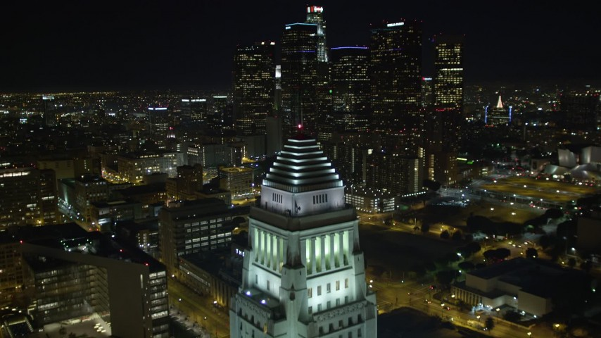 5K stock footage aerial video flying over Highway 110, revealing Los Angeles City Hall and skyline, California Aerial Stock Footage | DCA01_028