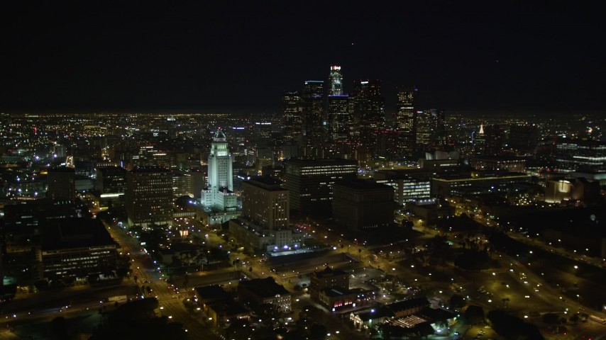 5K stock footage aerial video Downtown Los Angeles skyline and City Hall at night, California Aerial Stock Footage | DCA01_029