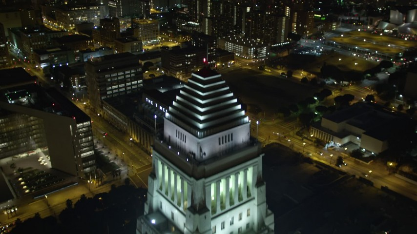 5K stock footage aerial video flying over Highway 110 and Los Angeles City Hall, revealing skyscrapers at night, California Aerial Stock Footage DCA01_030