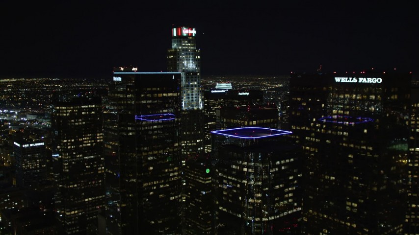 5K aerial video flying through Downtown Los Angeles skyscrapers at night, California Aerial Stock Footage | DCA01_031