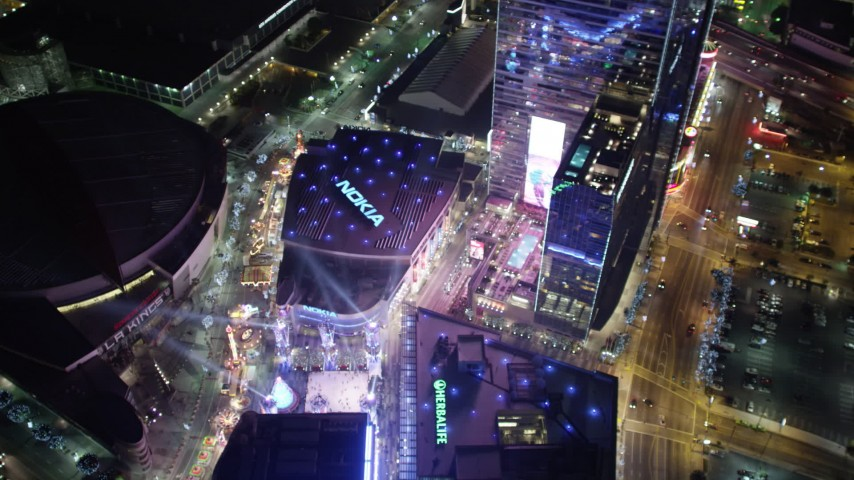 5K stock footage aerial video bird's eye view of Christmas fair at Nokia Theater at night, Los Angeles, California Aerial Stock Footage | DCA01_035