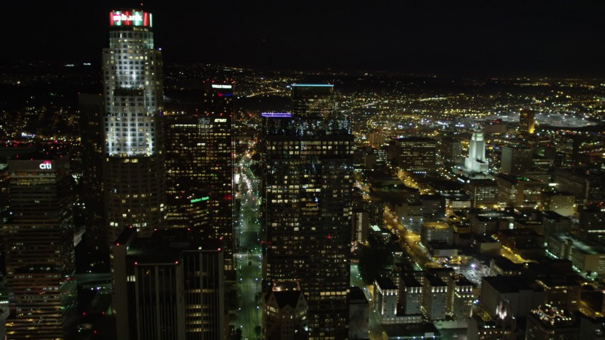 5K aerial video flying by skyscrapers in Downtown Los Angeles at night, California Aerial Stock Footage DCA01_053