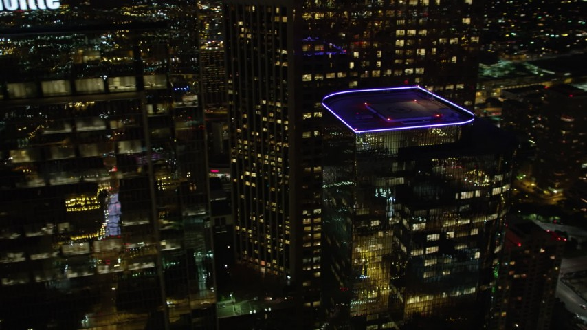 5K stock footage aerial video flying by skyscrapers in Downtown Los Angeles at night, California Aerial Stock Footage | DCA01_054