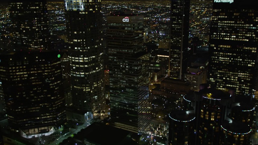 5K aerial video flying by skyscrapers and public library in downtown Los Angeles at night, California Aerial Stock Footage | DCA01_055