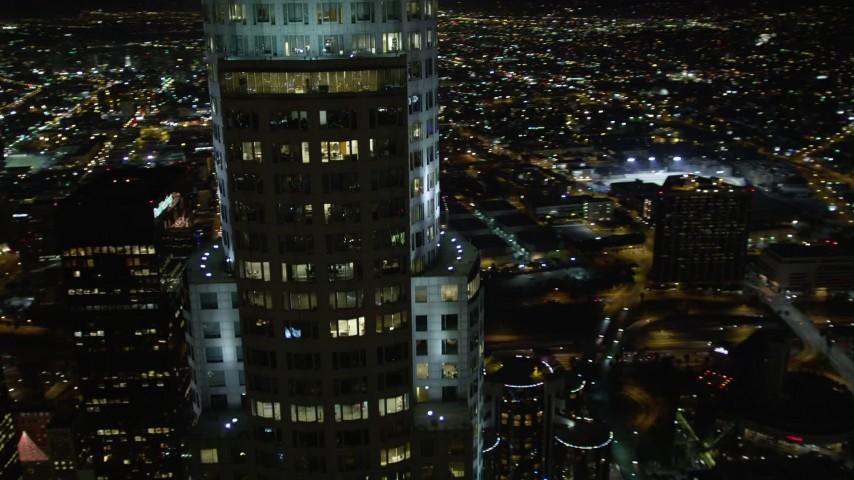 5K stock footage aerial video flying by skyscrapers and buildings in Downtown Los Angeles at night, California Aerial Stock Footage DCA01_056