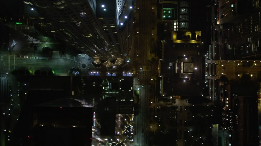 5K aerial video bird's eye view of West 5th Avenue, tilt up to skyscrapers in Downtown Los Angeles at night, California Aerial Stock Footage | DCA01_057