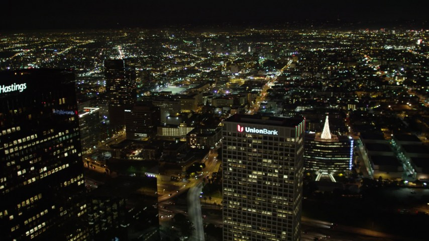 5K stock footage aerial video flying by Downtown Los Angeles office towers at night, California Aerial Stock Footage | DCA01_058