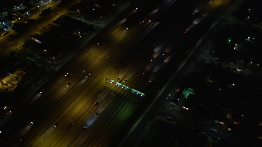 5K aerial video tracking traffic on Highway 110, tilt up to reveal Hwy 110/ I-105 interchange at night, Los Angeles, California Aerial Stock Footage | DCA01_066