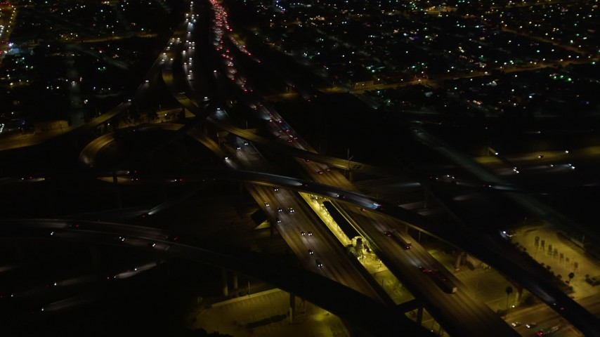 5K stock footage aerial video orbiting the Highway 110/ Interstate 105 interchange at night, Los Angeles, California Aerial Stock Footage | DCA01_067