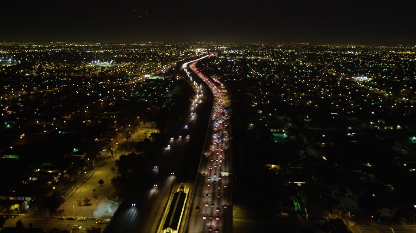 5K stock footage aerial video following I-105 passing through city lights at night, Hawthorne, California Aerial Stock Footage | DCA01_069