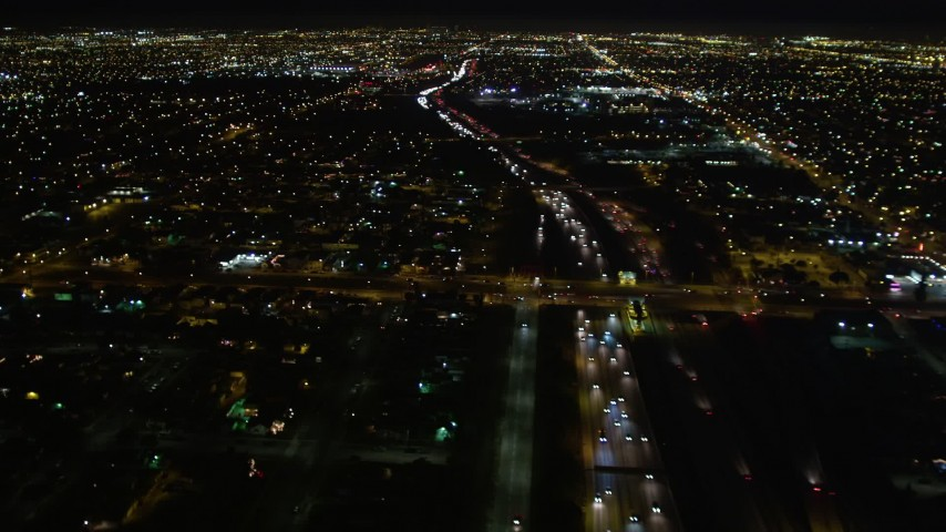 5K stock footage aerial video flying over I-105 and a residential neighborhood in Hawthorne at night, California Aerial Stock Footage | DCA01_070
