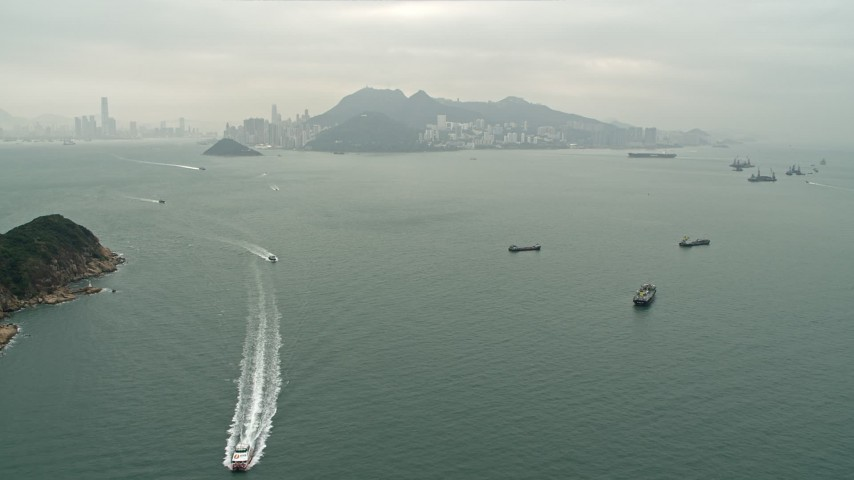 4K stock footage aerial video approach ferries and cargo ships near Hong Kong Island and Victoria Harbor, China Aerial Stock Footage | DCA02_009