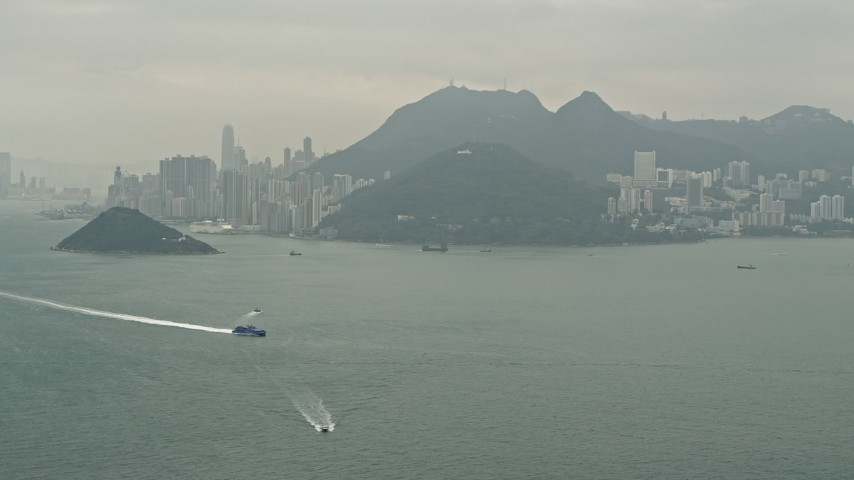 Approach Hong Kong Island as a ferry passes, China Aerial Stock Footage | DCA02_010