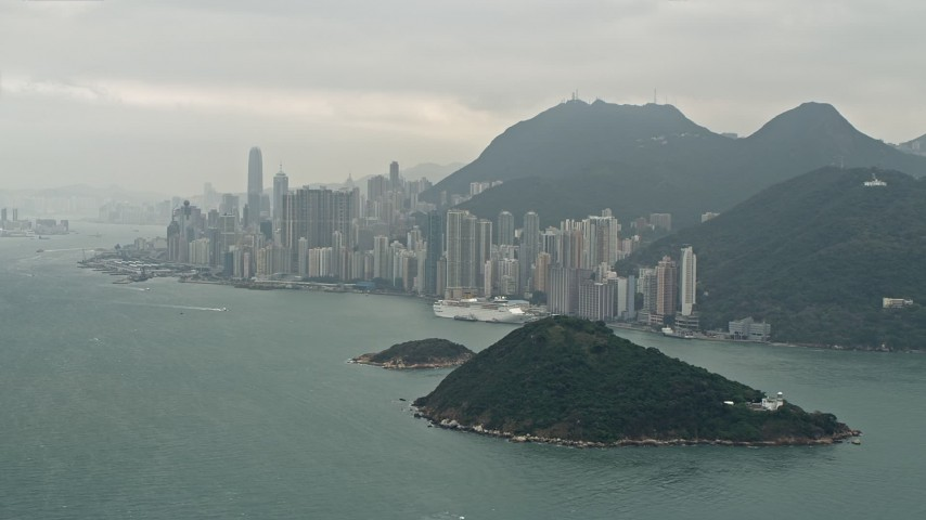 4K stock footage aerial video of Victoria Harbor and skyscrapers on Hong Kong Island, China Aerial Stock Footage | DCA02_012
