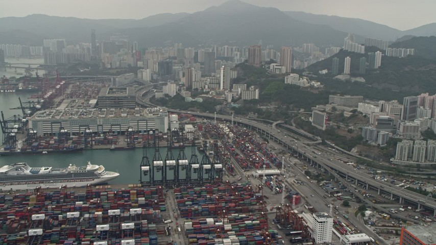 4K stock footage aerial video tilt from Port of Hong Kong to reveal Kwai Chung apartment buildings, Hong Kong, China Aerial Stock Footage | DCA02_017