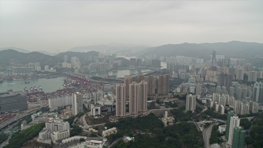 4K stock footage aerial video pan from Rambler Channel across Kwai Chung apartment complexes, Hong Kong, China Aerial Stock Footage | DCA02_019