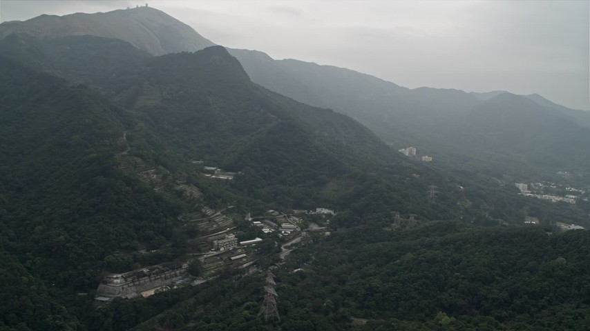 4K stock footage aerial video of botanical garden at the base of mountains in the New Territories, Hong Kong, China Aerial Stock Footage   DCA02_029