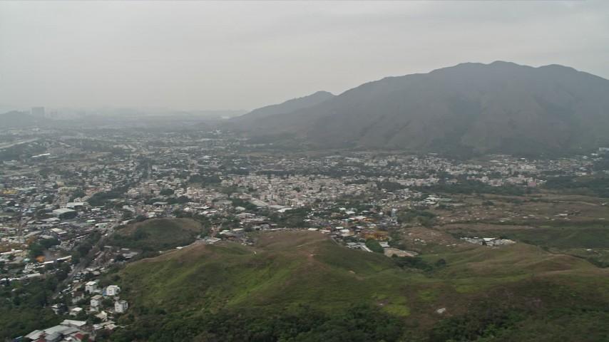 4K stock footage aerial video of Shek Kong neighborhoods and Kai Kung Leng mountain peak in the New Territories, Hong Kong, China Aerial Stock Footage   DCA02_031