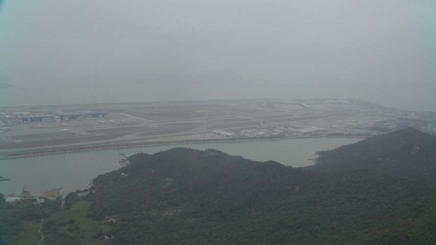 4K stock footage aerial video pan across Hong Kong International Airport, Hong Kong, China Aerial Stock Footage | DCA02_046