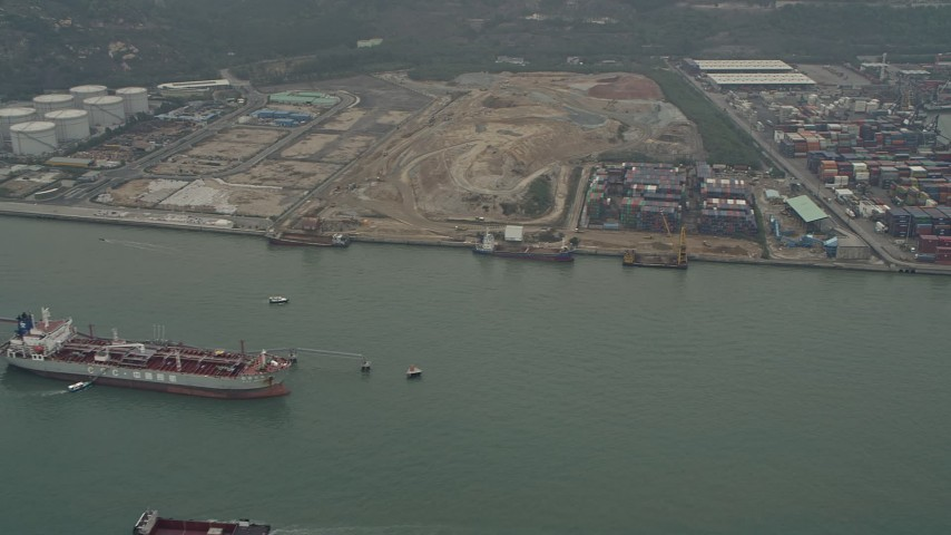 4K stock footage aerial video of oil tanker near cargo containers at Pillar Point port, New Territories, Hong Kong, China Aerial Stock Footage | DCA02_055
