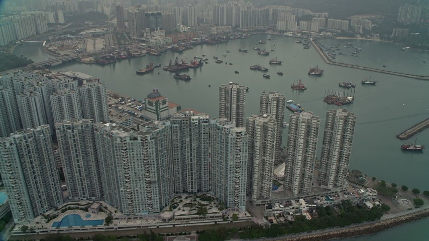 4K stock footage aerial video of waterfront apartments high-rises and Castle Peak Bay in New Territories, Hong Kong, China Aerial Stock Footage | DCA02_059
