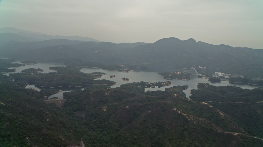 Approach Tai Lam Chung Reservoir in New Territories, Hong Kong, China Aerial Stock Footage | DCA02_064